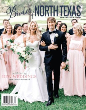 Bride and groom smiling as their bridesmaids and groomsmen are is in blush and black, walking behind them, on the cover of the Brides of North Texas magazine