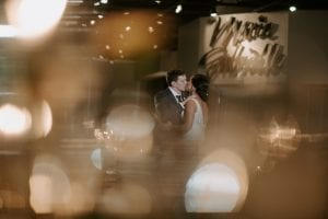 Bride and groom kissing during their private last dance during their reception in Marie Gabrielle