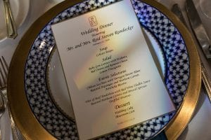 Close up of the menu card on the blue and white patterned plate
