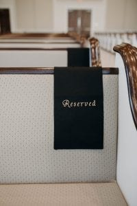 Reserved sign on a pew in a chapel