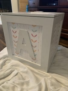 A decorative white wooden box with the letter A on it