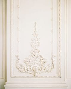 Detail shot of a white column with a pattern running through it
