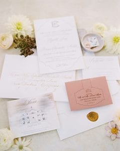 Blush and white wedding stationery suite with gold seal, with a sketch of the venue called The Olana