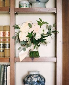 Bridal bouquet positioned on a bookshelf