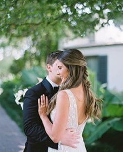 Groom gives bride a kiss on her cheek
