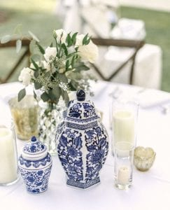 Ginger vases and a floral arrangement, with a cluster of candles on a table