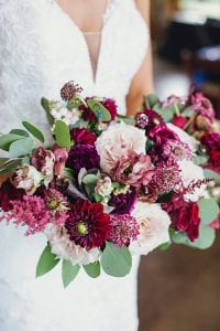 Bridal bouquet made with burgundy, blush and ivory flowers