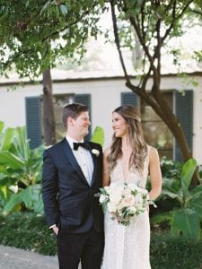 Bride and groom looking at each other lovingly in a botanical garden