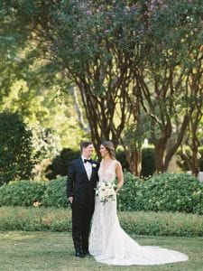 Bride and groom looking at each other lovingly at the dallas arboretum