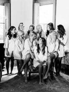 Bride and her bridesmaids smiling in their robe and pajamas