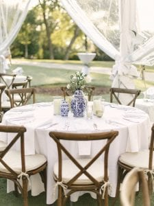 table and crossback chairs set up for a wedding