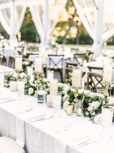 garland of flowers and candles running down a table for a wedding reception