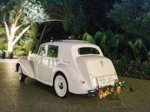 Rolls Royce waiting in the driveway with a Just Married sign at the back